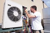stock photo of hvac  - HVAC technician working on a mini - JPG