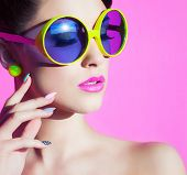 picture of cosmetology  - Colorful summer portrait of an attractive young woman with sunglasses  - JPG