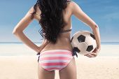 picture of backside  - Backside sexy woman with a soccer ball at beach - JPG