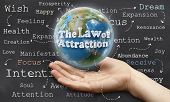 stock photo of laws-of-attraction  - Holding the World with The Law of Attraction - JPG