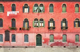 stock photo of duplex  - Duplex colored house on the island of Murano near Venice in Italy - JPG