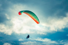 picture of parasailing  - Paragliding extreme Sport with blue Sky and clouds on background Healthy Lifestyle and Freedom concept Summer Vacations - JPG