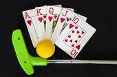 stock photo of flush  - Mini golf club and ball with a royal flush poker hand - JPG