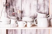 stock photo of shabby chic  - Shelves in the rack in the kitchen at shabby chic style - JPG