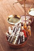 image of vedic  - Little bottles with spices in a wooden bowl in the kitchen - JPG