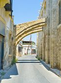 foto of larnaca  - The narrow street with the buttresses of the old mosque Larnaca Cyprus - JPG