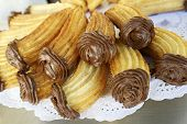 pic of churros  - Group of typical churros at a stall - JPG