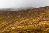 foto of galway  - Low hanging clouds covering the mountain in Galway - JPG