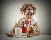 stock photo of biscuits  - Young woman eating biscuits  - JPG