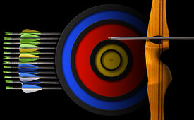stock photo of fletching  - Detail of a sports wooden bow with a set of arrows and target on a black background - JPG