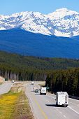 picture of trailer park  - RV and buses on the road in Banff National Park - JPG