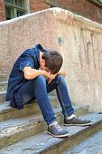 picture of pity  - Sad Young Man on the landing Steps of the Old House - JPG