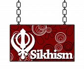 picture of khanda  - Sikh religious symbol over red black floral signboard - JPG