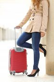 picture of legs air  - Vertical view of a tourist woman legs waiting with a suitcase in an airport or station - JPG