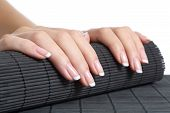 foto of french manicure  - Woman hands with french manicure ready for a treatment isolated on a white background - JPG