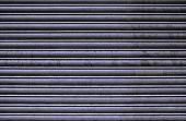 stock photo of roller shutter door  - Rusty Steel Roller Shutter Door Texture and Background - JPG