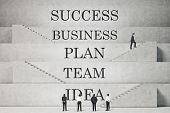 image of staircases  - businessman climbing on staircase with business text - JPG