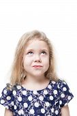 stock photo of sarcastic  - Beautiful little girl skeptically looking on something isolated over white background - JPG