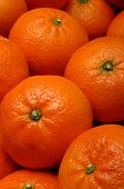 picture of clementine-orange  - Lot of orange mandarins in a wooden pack