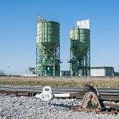 foto of silos  - Exchange railway manual with the background industrial silos - JPG