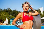 picture of turban  - Beautiful fashionable woman near the pool wearing colored turban - JPG