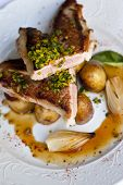 picture of veal  - Piece of veal potatoes shallots and sauce  - JPG