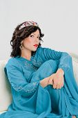picture of yashmak  - Beautiful Adult arabian woman in blue abaya - JPG
