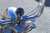 image of chopper  - reflection of a chopper motorcycle rider on the motorcycle odometer  - JPG