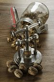 pic of nutcracker  - nutcracker and pile of walnuts in shell in soft diffused light - JPG