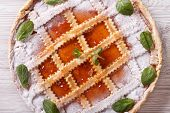 pic of apricot  - Italian crostata with apricot jam close up on the table - JPG