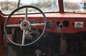 stock photo of steers  - Old bus interior view on steering wheel and control table - JPG