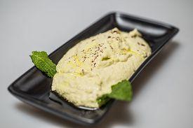 image of humus  - Traditional mediterranean meze humus served on a plate - JPG