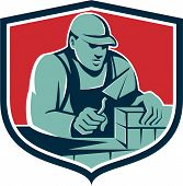 picture of masonic  - Illustration of a mason masonry construction worker holding trowel working on bricks viewed from front set inside shield crest done in retro style - JPG