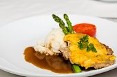 picture of mashed potatoes  - A dinner of baked pork with sauce and gravy with asparagus and mashed potatoes - JPG