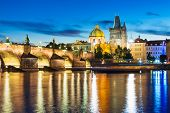 picture of old bridge  - Scenic summer evening view of the Old Town ancient architecture with Vltava river pier and Charles Bridge in Prague - JPG