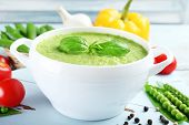 foto of vegetable soup  - Tasty peas soup and vegetables on table close up - JPG