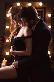 picture of cuddle  - Portrait of a romantic couple cuddling vertical - JPG