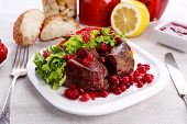 image of deer meat  - Tasty roasted meat with cranberry sauce on plate - JPG