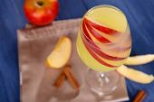 pic of cider apples  - Glass of apple cider with fruits and cinnamon on table close up - JPG