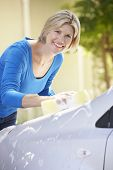 stock photo of car carrier  - Woman Washing Car In Drive - JPG