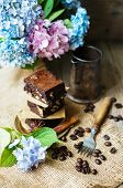 stock photo of hydrangea  - Home made brownies on vintage plate with vintage silverware and hydrangea flowers - JPG