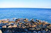 foto of atlantic ocean  - Dry Lava Coast Beach in the Atlantic Ocean - JPG