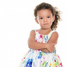 stock photo of angry  - Cute and funny small hispanic girl making an angry face isolated on white - JPG