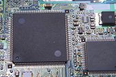 stock photo of plc  - A closeup of a printed circuit board - JPG