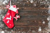 Christmas decoration stocking and toys hanging over rustic wooden background poster