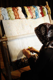 picture of handloom  - Woman working at the loom - JPG