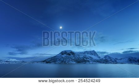 Snow Covered Mountains Against Blue