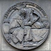 PARIS, FRANCE - JANUARY 11: Leonardo da Vinci, was an Italian Renaissance polymath. Stone relief at  poster