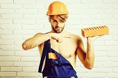 Young Handsome Bearded Macho Man Builder With Sexy Muscular Athletic Strong Body Has Strong Hands In poster