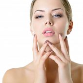 Young woman touching her face and neck. Beauty treatment for young beautiful face. Skin care, beauti poster